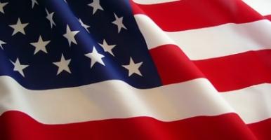 Dr.Kristie Chiropractor waves her online American Flag